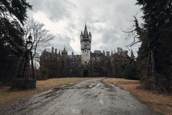 An old, abandoned and creepy castle on a dark and gray day in fall