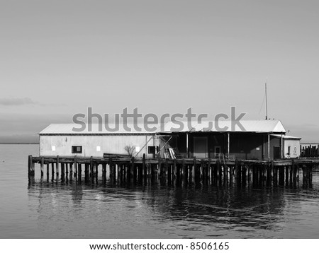 An old abandoned building on a pier in the Pacific Northwest.