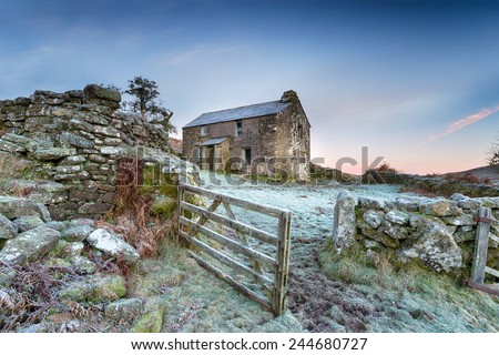 An old abandoned cottage on a frosty winter morning high up on Bodmin Moor in Cornwall