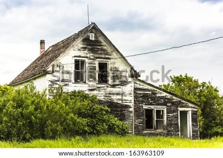An old abandoned house on a farm yard #163963109