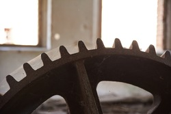 An old abandoned mill. Antique millstone mechanism