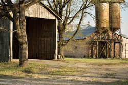 An old abandoned rustic wooden shed and granary, close-up. Agriculture, farm industry, traditional architecture, USA, Wild West, history, western, zombie, horror and other graphic resources concepts