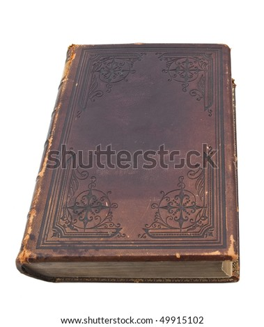 An old, ancient book with a decorative leather cover isolated on a white background