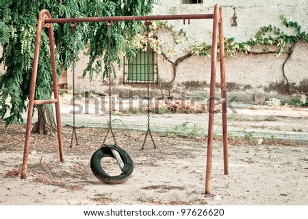 an old and lonely swing