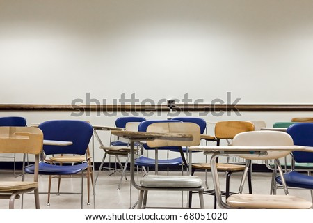 An old and messy classroom full of chairs