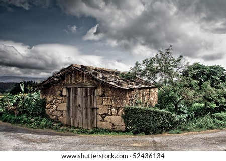 An old and rustic house surrounded with vegetation