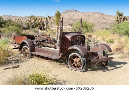 An old antique car left abandoned in the desert