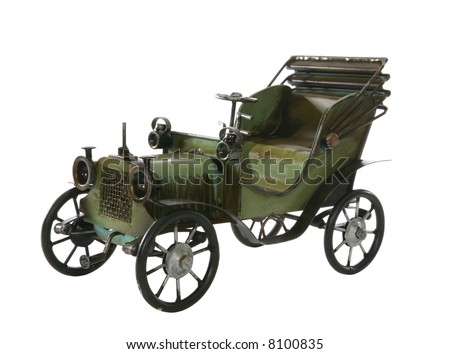 An old antique car over a white background