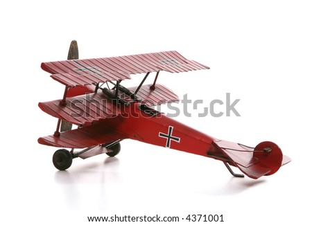 An old antique model airplane over a white background