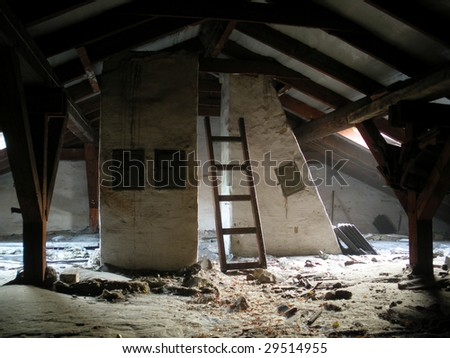 An old attic under a roof - stock photo
