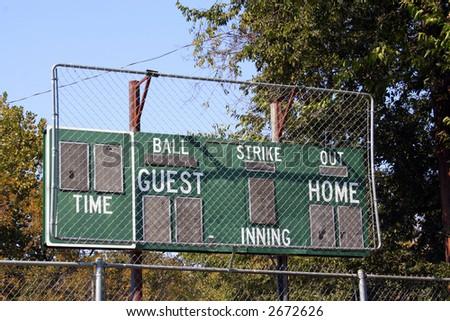 An old baseball scoreboard at a public park ballfield.