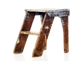An old, battered, paint-spattered step stool.  Isolated on white.