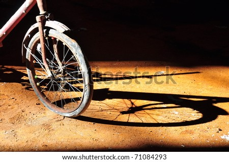 an old bike and its reflection