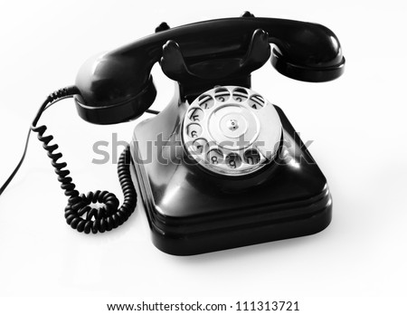 an old black telephon with rotary dial