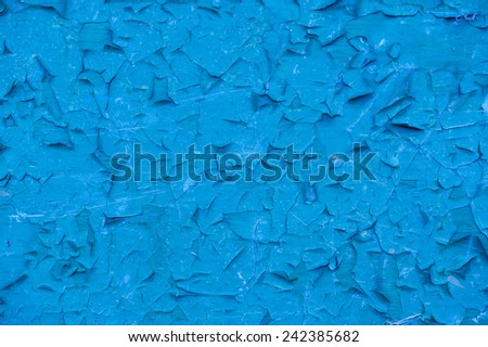 An old blue cracked painted wall as a background
