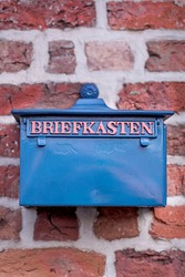 An old blue postbox with the german word