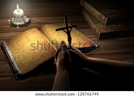 An old book and a crucifix on the table.