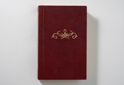 An old book with no title. Ornament or monogram and free space for title. Close-up