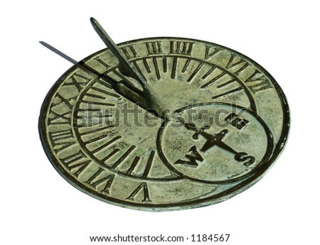 An old brass sundial, with a delicate green patina, showing mid-day. Isolated on white with a clipping path.