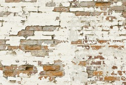 An old brick wall background with chipped paint, horizontal