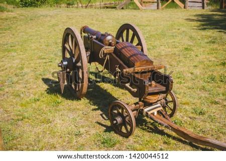 An old cannon that shoots cores. Antique weapons. Artillery guns. #1420044512