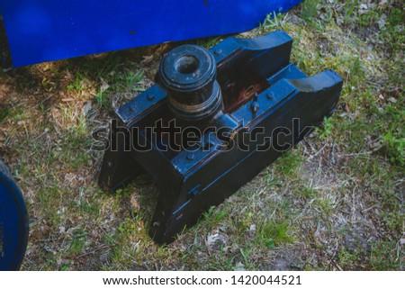 An old cannon that shoots cores. Antique weapons. Artillery guns. #1420044521