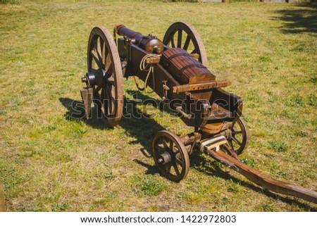 An old cannon that shoots cores. Antique weapons. Artillery guns. #1422972803