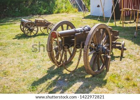 An old cannon that shoots cores. Antique weapons. Artillery guns. #1422972821