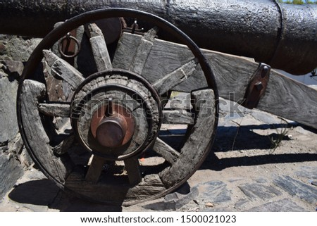 An old cannon wood wheel