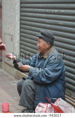 an old chinese man begging in an alley in Hong Kong