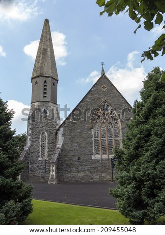 an old church with steeple in ireland - stock photo