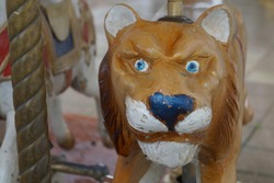 An old classic carousel. Vintage carousel. Figures of animals, lion. Narva castle. Estonia