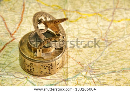 An old compass over a map