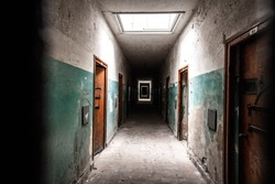 An old corridor of a creepy prison abandoned a long time ago.