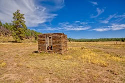 An old dilapidated Well House near Barney Tank south of Williams Arizona. Located on public land in the Kaibab National Forest. No property release needed.