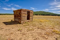 An old dilapidated Well House near Barney Tank south of Williams Arizona. Located on public land in the Kaibab National Forest.