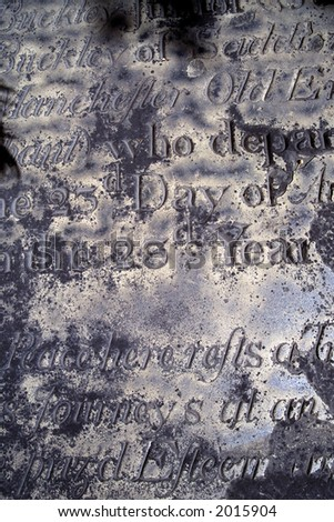 An old distressed and eroded epitaph.