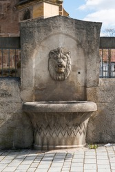 An old drinking fountain in the center of Roth bei Nuremberg, Germany.