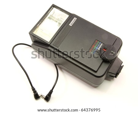 An old external hotshoe flash for a single lens reflex camera, SLR. - stock photo
