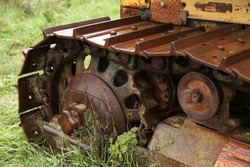 An old farm tractor tracks