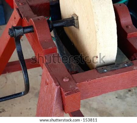 stock-photo-an-old-fashion-sandstone-grinding-wheel-153811.jpg