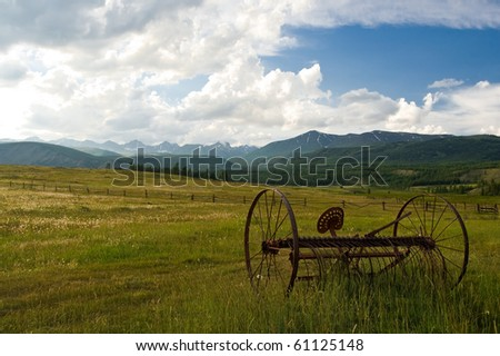 An old fashioned hay rake in a country field