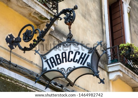 An old-fashioned Tabacchi, or Tobacco, sign above a shop in Venice, Italy.