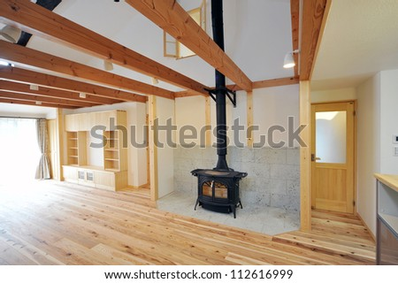 An old fashioned wood burning stove with a roaring fire-1-3