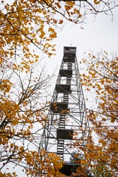 An old fire tower in fall colors in northern Minnesota.