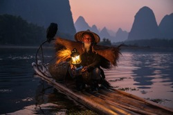 An old fisherman with a lamp on a raft