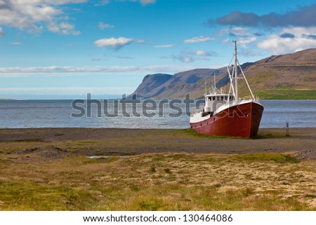 An old fishing vessel that shipwrecked on the northern coast of Iceland in the Westfjords region