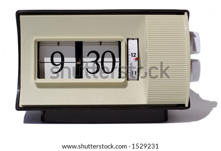 an old flip style clock displaying 9.30