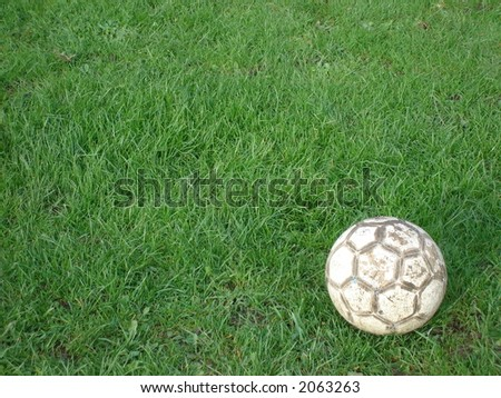 An old football on pitch -- Another hard training day ! - stock photo