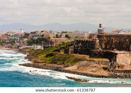 An old fortress on the colorful coast of Puerto Rico with old and new cities